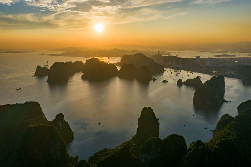 Ha Long Bay Sea Seascape Beauty In Nature Sky Tranquility Sunset Water Rock Tranquil Scene Scenics - Nature Solid Rock - Object Cloud - Sky Nature Idyllic Non-urban Scene Rock Formation No People Orange Color Outdoors