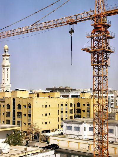 Construction site against buildings in city