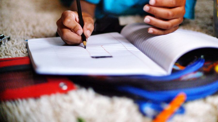 Close-up of child doing homework