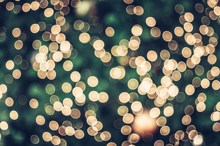 Defocused image of illuminated christmas tree at night