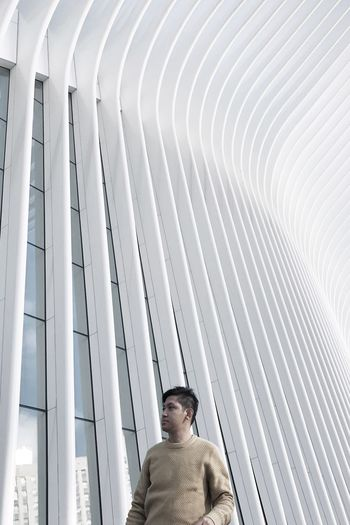 Woman looking at building