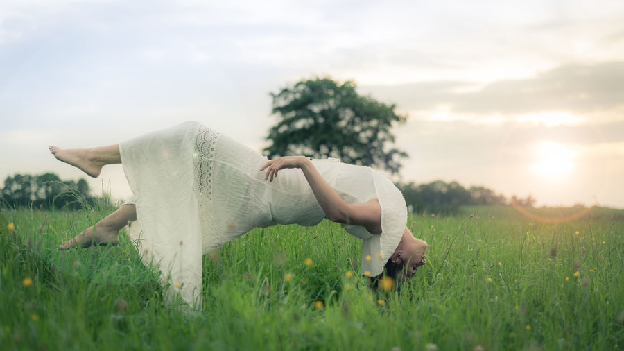 Woman Floating Over Field
