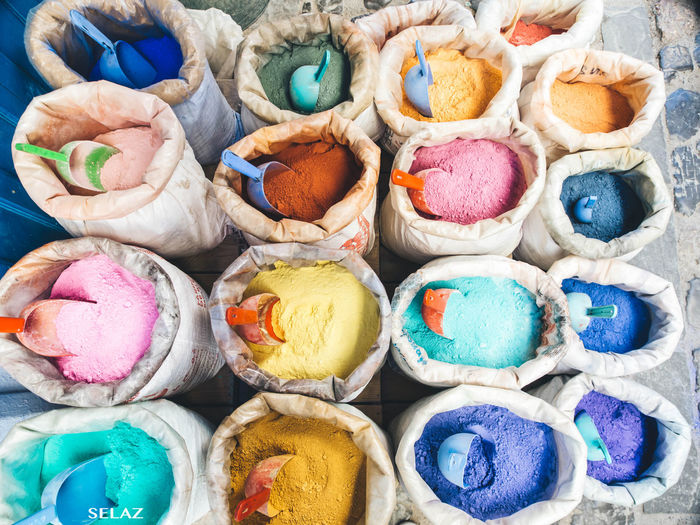 High angle view of multi colored paints