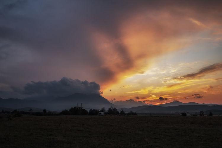 sunset landscape in Romania Romania Travel Photography Beauty In Nature Cloud - Sky Dramatic Sky Environment Idyllic Land Landscape Mountain Mountain Range Nature No People Non-urban Scene Orange Color Scenics - Nature Silhouette Sky Sunset Tranquil Scene Tranquility