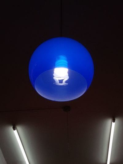 Illuminated Lighting Equipment Blue Ceiling Low Angle View Electric Light Modern Lit Taking Photo .