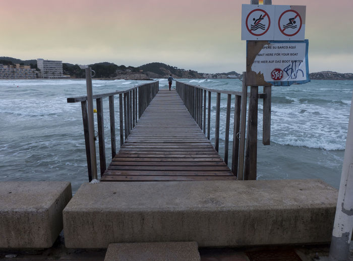 Balustrade Beach Beauty In Nature Boardwalk Boardwalk Photography Cement Communication Day Mallorca Mediterranean  Mediterranean Sea Nature Outdoors Paguera Pier Sea Sky SPAIN Text Timber Plank Water Waves Wooden