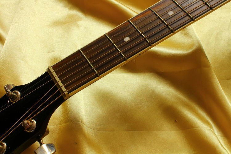 Arts Culture And Entertainment Classical Music Close-up Day Fretboard Guitar High Angle View Indoors  Music Musical Equipment Musical Instrument Musical Instrument String Musical Note No People String Instrument Woodwind Instrument