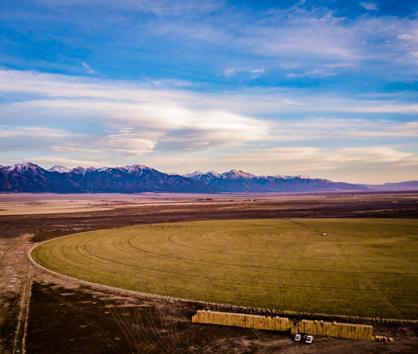 Drone  Farm Beauty In Nature Cloud - Sky Crop Circles Day Dronephotography Farming Field Grass Landscape Mountain Mountain Range Nature No People Outdoors Rural Scene Scenics Sky Tranquil Scene Tranquility