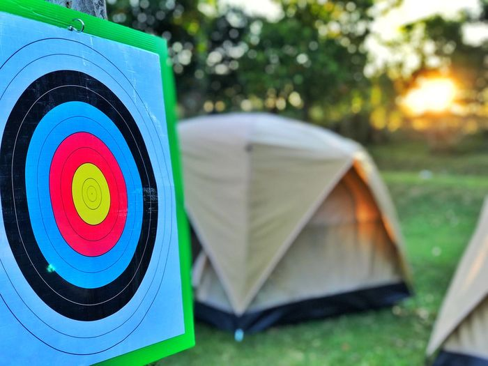 Morning Accuracy Aiming Archery Arrow - Bow And Arrow Campinglife Circle Close-up Day Focus On Foreground Geometric Shape Guidance Multi Colored Nature No People Outdoors Paper Plant Shape Small Group Of Objects Sport Sports Target Target Shooting