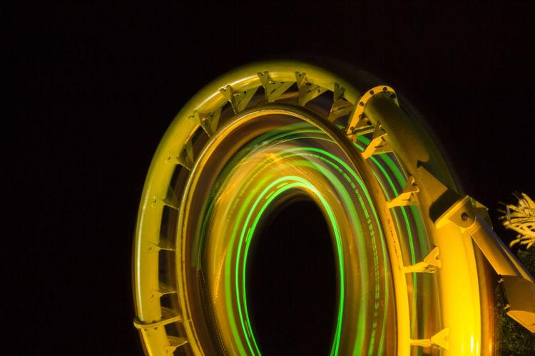 View Of Illuminated Amusement Park Ride At Night
