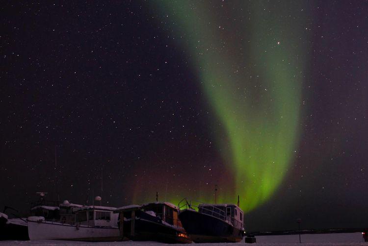 Scenic View Of Aurora Borealis Against Sky At Night