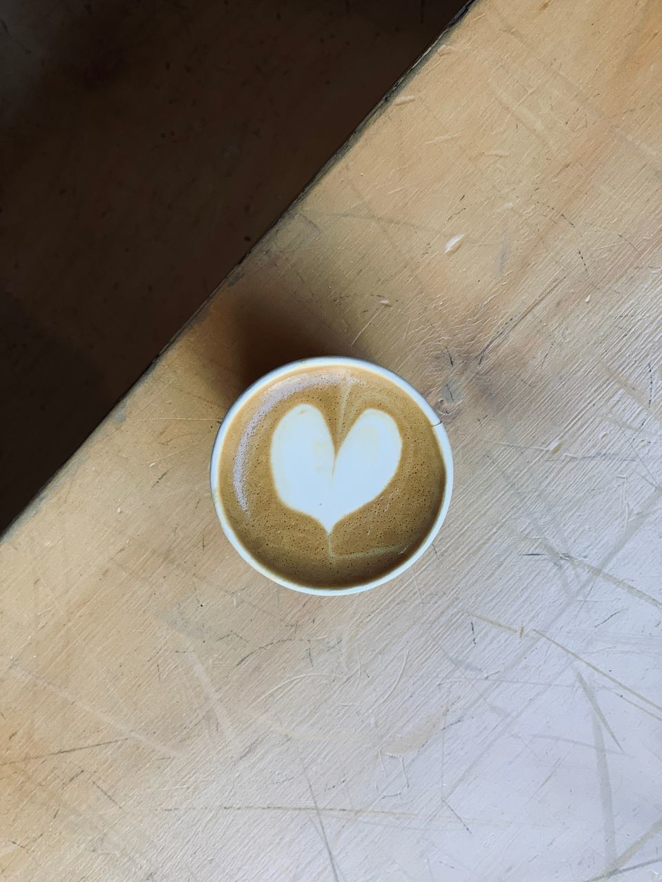 coffee, food and drink, cup, still life, coffee - drink, table, heart shape, frothy drink, coffee cup, refreshment, mug, drink, high angle view, indoors, freshness, froth art, no people, creativity, love, food, positive emotion, hot drink, latte, non-alcoholic beverage, crockery