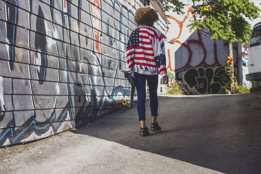 City Life Longboard USA Casual Clothing Day Flag Full Length Leisure Activity Lifestyles One Person Outdoors Real People Standing Stars And Stripes