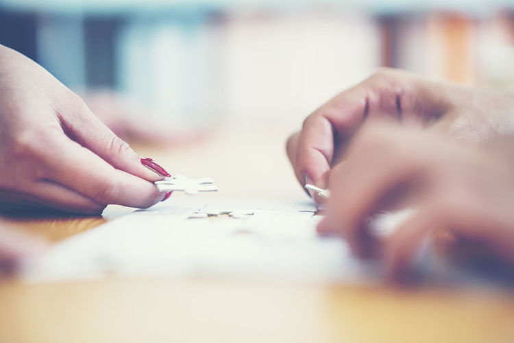 Adult Body Part Business Close-up Finger Hand Holding Human Body Part Human Hand Indoors  Leisure Activity Lifestyles Paper People Real People Selective Focus Table Unrecognizable Person Women Writing