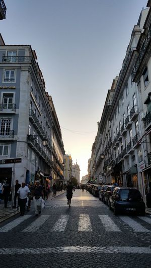 Running Man Architecture Building Exterior Built Structure Chiado City City Life Clear Sky Day Group Of People Large Group Of People Lifestyles Lisbon Men Outdoors People Real People Road Sky Street Sunset Walking Women