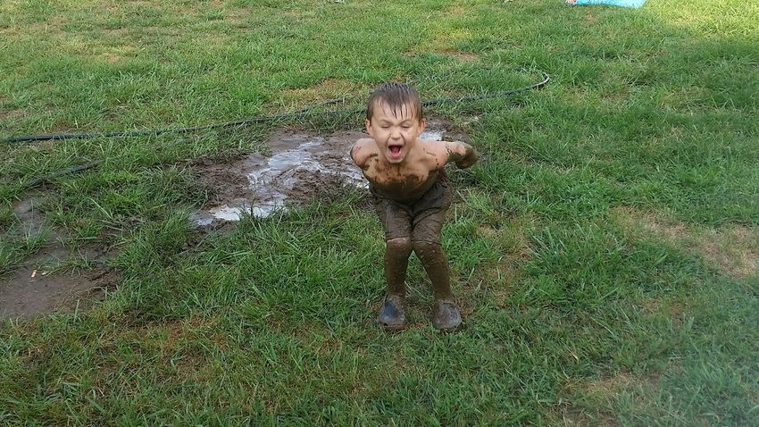 Muddy Playing In Mud Fun💕 Family 🙏🙌 Missouri Ozarks, USA 💥💖 Boys Motion Water Summer 👫 Grandkids 💙💛💜 Playing Preschooler Portrait Looking At Camera High Angle View Grass Green Color Mud Flowing Water Splashing