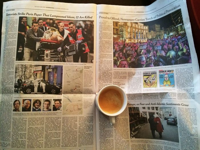 Coffee and the NYT on January 8, 2015 in the Forest Hills neighborhood of Queens borough of New York City. Jesuischarlie