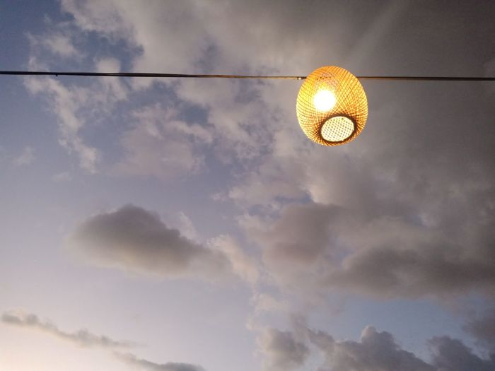 Low angle view of illuminated lamp against sky