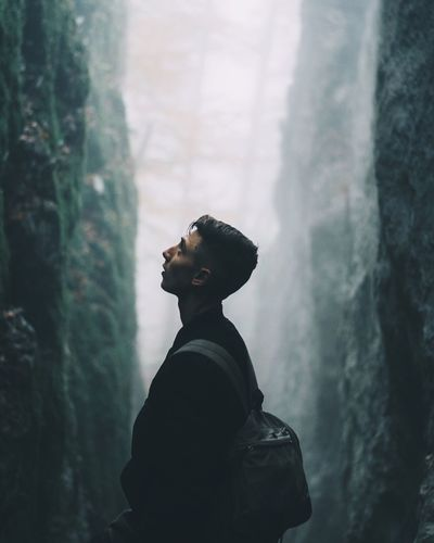 light and reflection One Person Young Adult Young Men Real People Waist Up Side View Men Beard Day Standing Leisure Activity Nature Mist Fog Cliff Portrait Finding New Frontiers