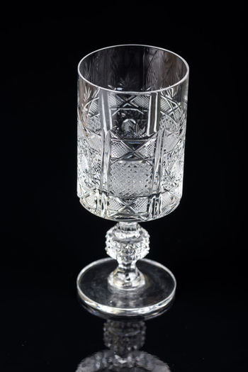 Crystal glass on a black background with reflections Beverage Black Background Isolated Alcohol Background Bar Black Reflection Crystal Glass Crystal Glasses Dark Background Drink Fancy Background Fancy Glass Gallant Glass Transparent