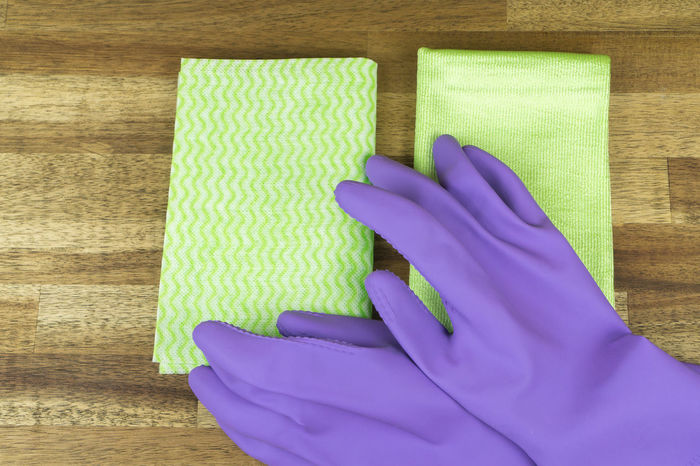 Hygiene Blue Cleaning Cleaning Equipment Close-up Day Disinfection High Angle View Housecleaning Housework Human Body Part Human Hand Hygiene Indoors  Occupation One Person People Protective Glove Protective Workwear Purple Spring Cleaning Textile Washing Washing Up Glove Working