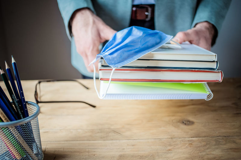 Midsection of man working on table at home