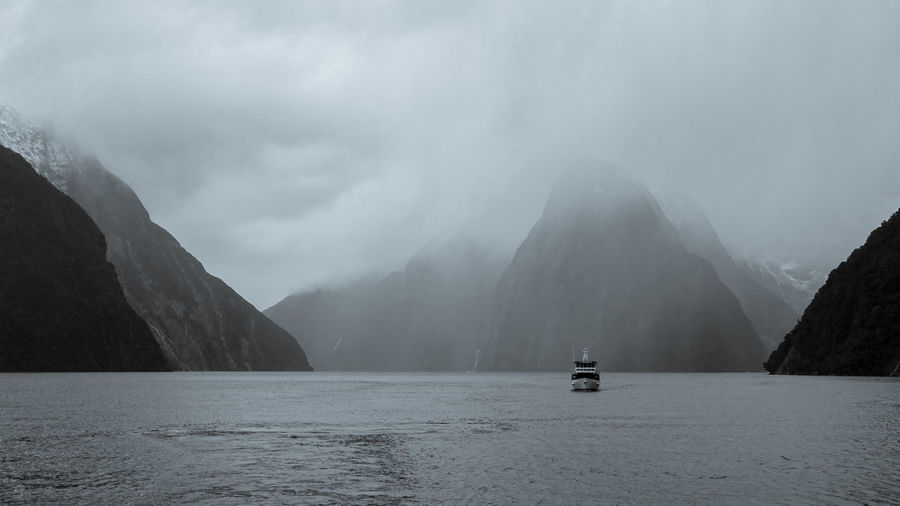 Cruise ship at Milford Sound Cruise Ship Black & White Beauty In Nature Day Fog Mode Of Transportation Mountain Nature Nautical Vessel New Zealand No People Non-urban Scene Outdoors Passenger Craft Sailboat Sailing Scenics - Nature Sea Sky Tranquil Scene Tranquility Transportation Travel Water Waterfront