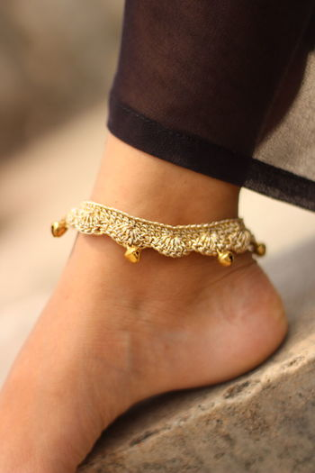 Close-up of woman wearing anklet
