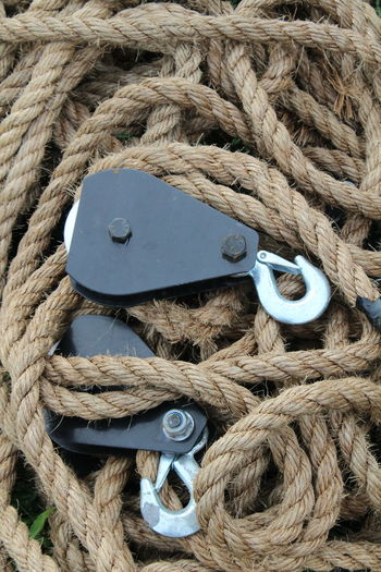 High angle view of hooks on ropes at harbor