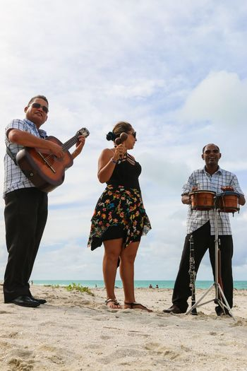 Trio ensemble performing on the beach, Cuba, Varadero Cuba. Varadero Beach Real People Sky Playing Music Guitar Drums Day Trio Outdoors Smiling Atlantic Ocean Sand Musicians Cuba Resort Enjoyment Togetherness Varadero Lifestyles Ensemble Musical Instrument Young Women Leisure Activity Mid Adult Men