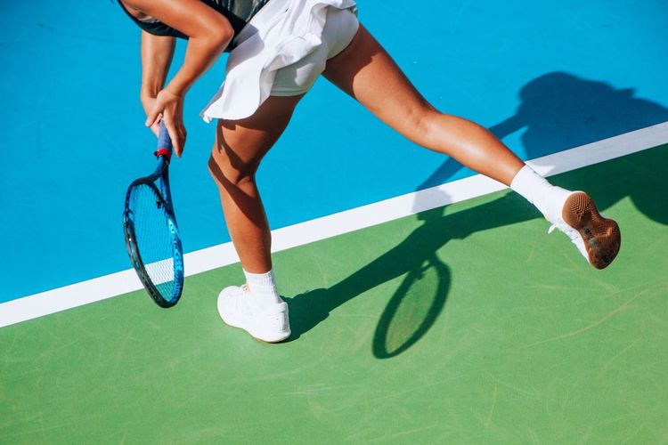Low section of woman playing tennis