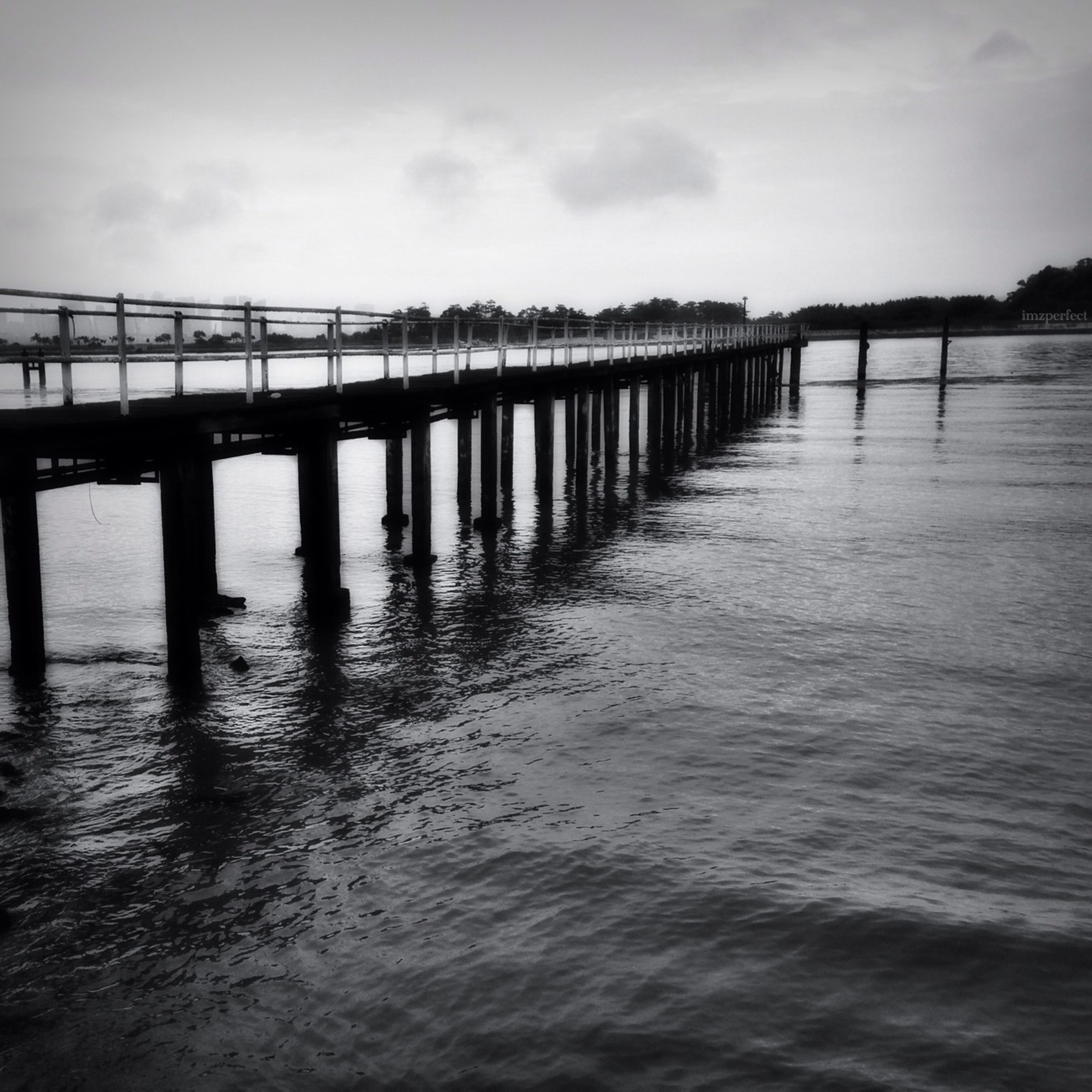 water, built structure, architecture, bridge - man made structure, connection, waterfront, sky, river, bridge, pier, reflection, sea, cloud - sky, rippled, nature, tranquility, engineering, no people, outdoors, railing