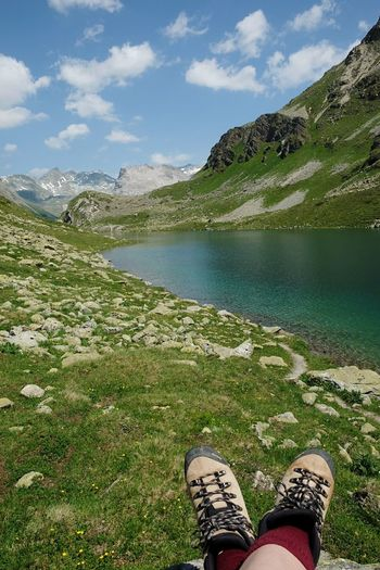 Low section of person relaxing on mountain