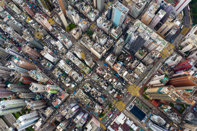 Top view of Hong Kong city Hong Kong City Urban Sham Shui Po Kowloon Side District Downtown Mong Kok Outdoor Yau Ma Tei Shopping Center Aerial View Top Drone  Above Building Street Business Architecture Travel Skyline Panoramic Landmark Tower Cityscape Helicopter ASIA Sky Fly Over Down Top Down Bird Eye Hk Hong Kong