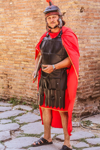Roman Roman Romanattire Colloseum In Rome Discoveritaly Rome Italy Ancient Architecture Architecture Detail Canon Travelblogger Instatravel Travelphotography Italy❤️ Wanderlust Canonphotography Capetownphotographer Photoblogger Tourists VSCO Traveltheworld Roma Italy Portrait Full Length Looking At Camera Red Men Standing Sport Front View Beard