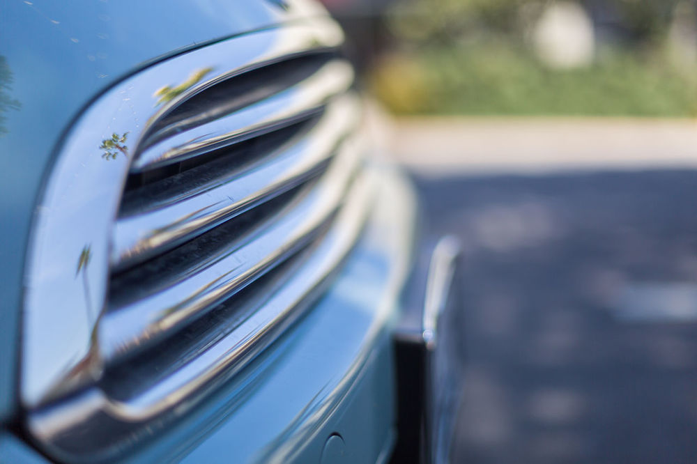 car grills Car Close-up Day Focus On Foreground Grill License Plate Metal Metalic No People Outdoors Reflection Reflection Of Palm Tree Reflective Road Shade Shaded Shiny Street Vehicle
