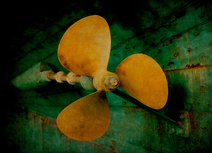 Boat Propeller. A boat propeller on a fishing boat being worked on at the Port Townsend, Washington boat yard. Close-up No People Wood - Material Old Still Life Yellow Propeller Boat Vessel Marine Green Port Townsend Detail Textured  Texture Artistic Hull Wooden Boatyard Shaft Washington Washington State Maritime