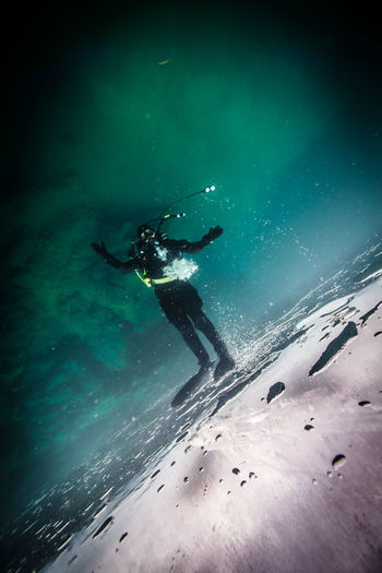 Tilted Shot Of Scuba Diver Under Water