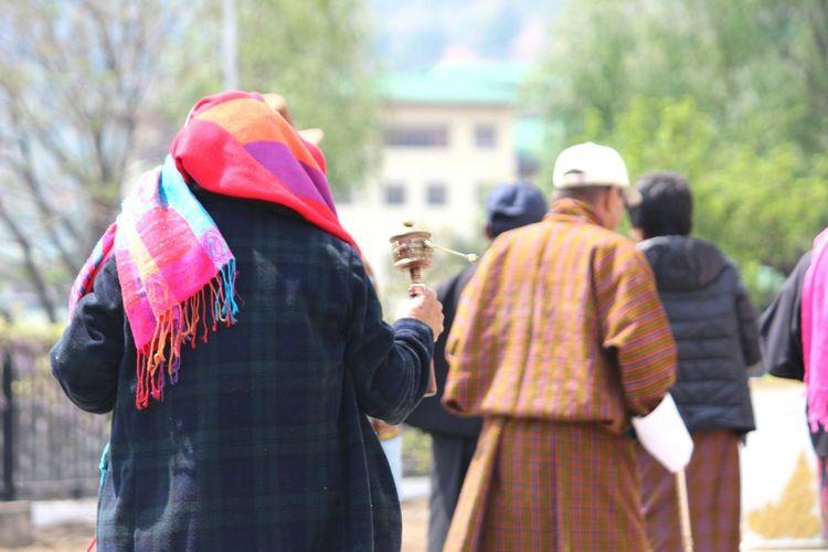 The Street Photographer - 2017 EyeEm Awards street Bhutan Bhutanese Bhutan Diaries Bhutaneselocal Thimpu Street Thimpu_temple Thimphu Thimphutown Beatiful Religious  People Faith Worship God