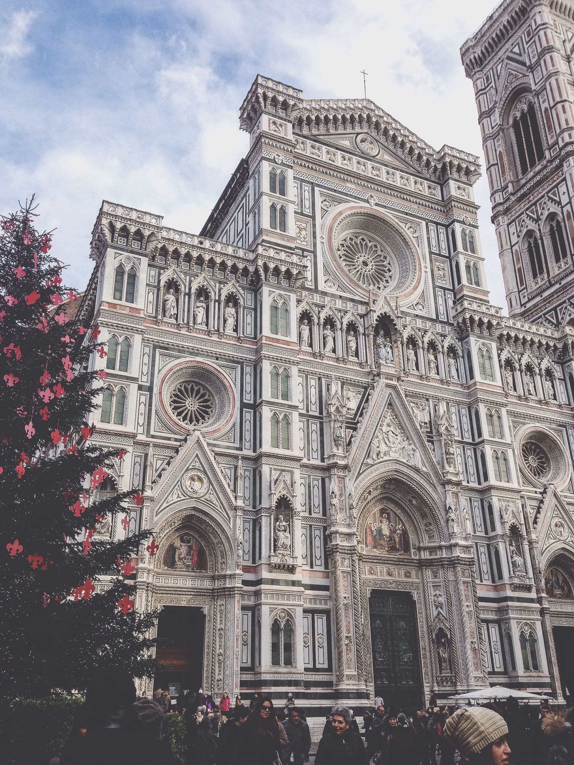 architecture, building exterior, built structure, religion, place of worship, church, spirituality, low angle view, sky, cathedral, travel destinations, history, famous place, facade, day, tree, outdoors, city