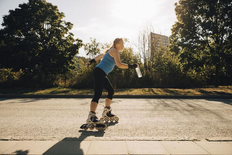 Full length of man skateboarding on skateboard against sky