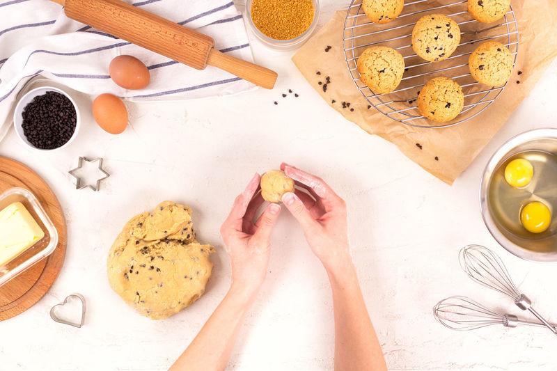 High angle view of woman preparing food on table