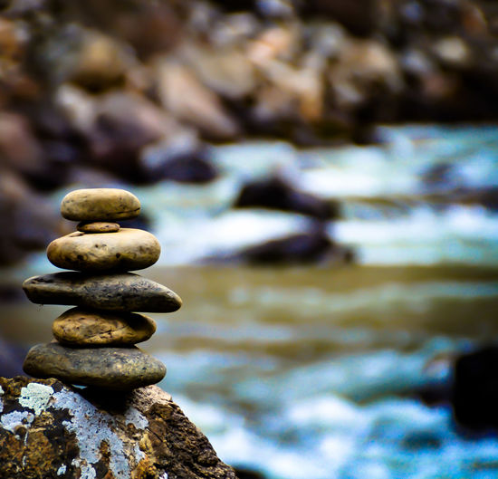 Stones stacked on rock