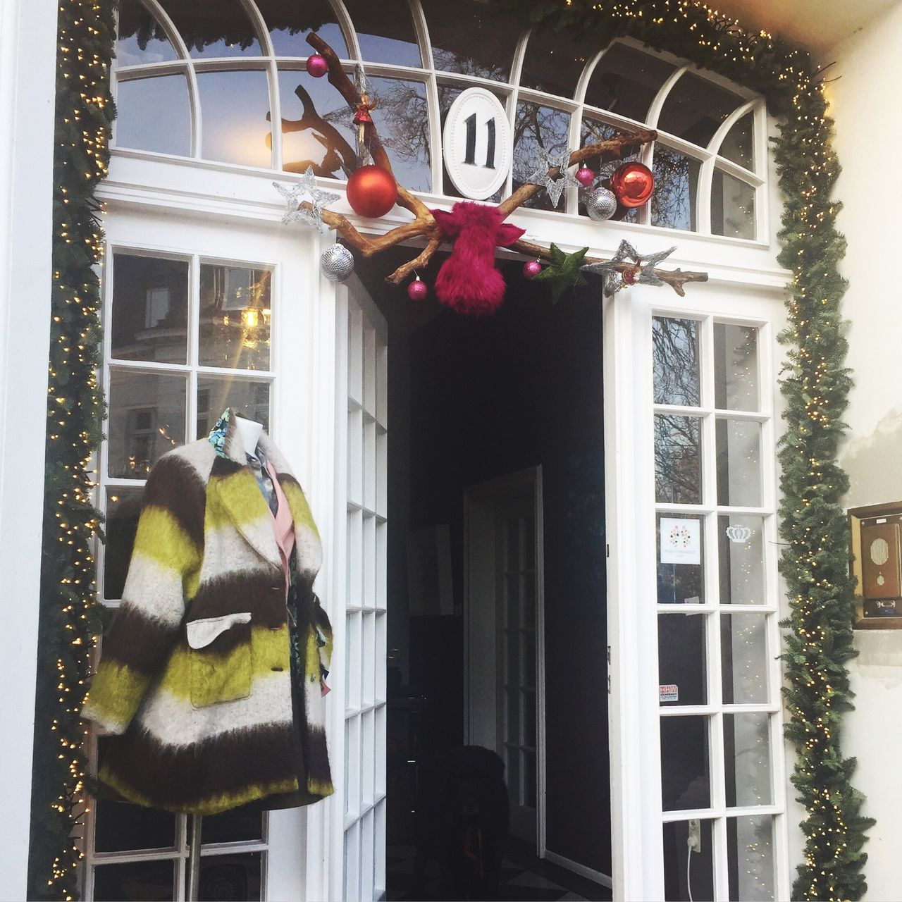 building exterior, christmas, text, window, architecture, hanging, built structure, celebration, christmas decoration, outdoors, tradition, holiday - event, day, no people, tree, mammal, animal themes, flower