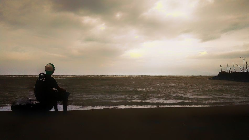 Mature Adult Dog Sea One Man Only One Mature Man Only One Person Only Men Adult People Cloud - Sky Beach Outdoors Storm Cloud Horizon Over Water Silhouette