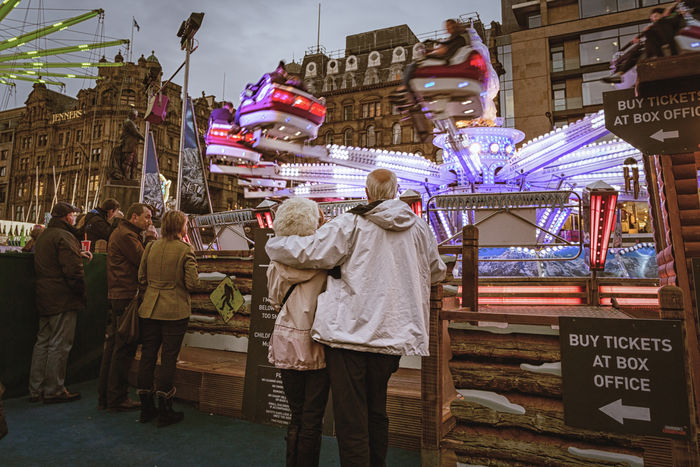 A fairground attraction: older couple at Edinburgh Christmas market Outdoors Christmas Market Fairground Attraction Older Couple Love Edinburgh Scotland People EyeEmNewHere City Evening Night Lights First Eyeem Photo