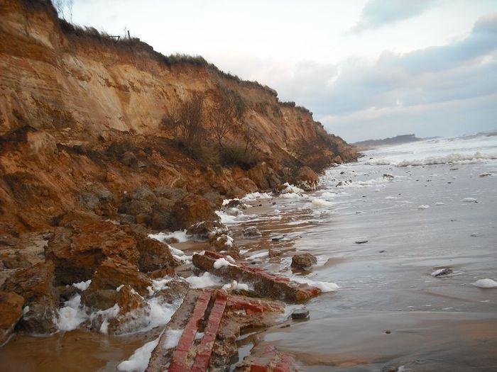 Coastal erosion. Storm surge southwold Coastal Erosion Cliffs Southwold Storm Surge Southwold Sky Water Beauty In Nature Mountain Nature Land Tranquility