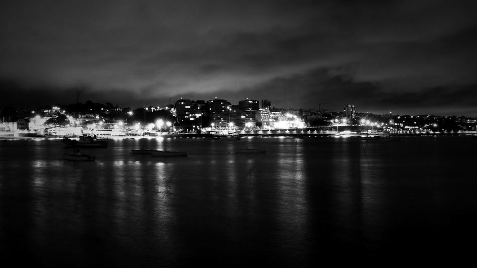 The night lights on the bay in Cascais Black And White Boats Cascais Cascais E Estoril Cascais Portugal Cascais Tem Outro Encanto... City Cityscape Clouds Cloudy Dark Fresh On Eyeem  Illuminated Light Nature Night Overcast Portugal Portugal_lovers Scenics Sky Tranquility Water Water Reflections Week On Eyeem