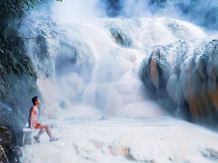 Wanna visit MAINIT SULFURIC HOT SPRING? Enough of a manmade hot a must visit steaming waterfall fresh from Kniazeff, one of the 22 active volcanoes based on PHIVOLCS. Entrance fee: Php10.00 only! You're right! For just Php10.00 only, it will kill 99% of germs and bacteria from your body. 😂😂😂 Seriously, it's P10.00 only. This is located in the Municipality of Maco from the province of Compostella Valley in Davao Region, Philippines. #travel #travelphotography #Nature  #photography #EyeEmNewHere #likeforlike #likemyphoto #qlikemyphotos #like4like #likemypic #likeback #ilikeback #10likes #50likes #100likes #20likes #likere # Water Spraying Waterfall Men Motion Splashing Hot Spring Steam Volcanic Landscape