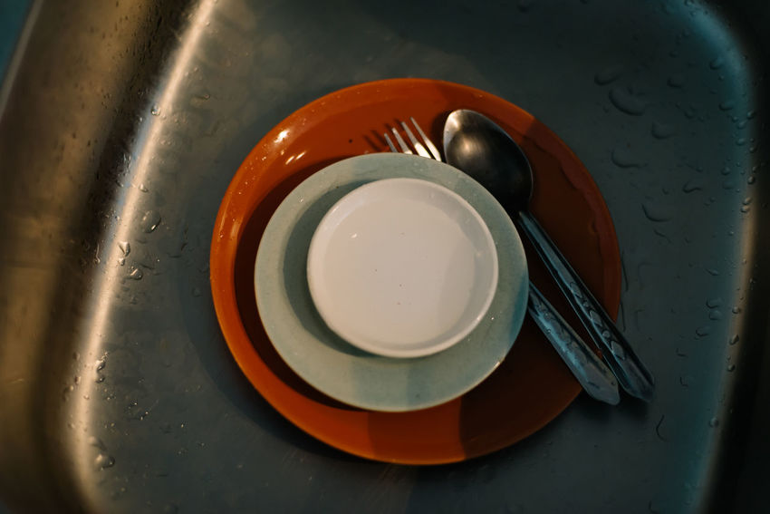 Alloy Bowl Close-up Crockery Directly Above Domestic Room Eating Utensil Food And Drink Fork High Angle View Household Equipment Indoors  Kitchen Utensil Metal No People Orange Color Plate Sink Spoon Steel Still Life